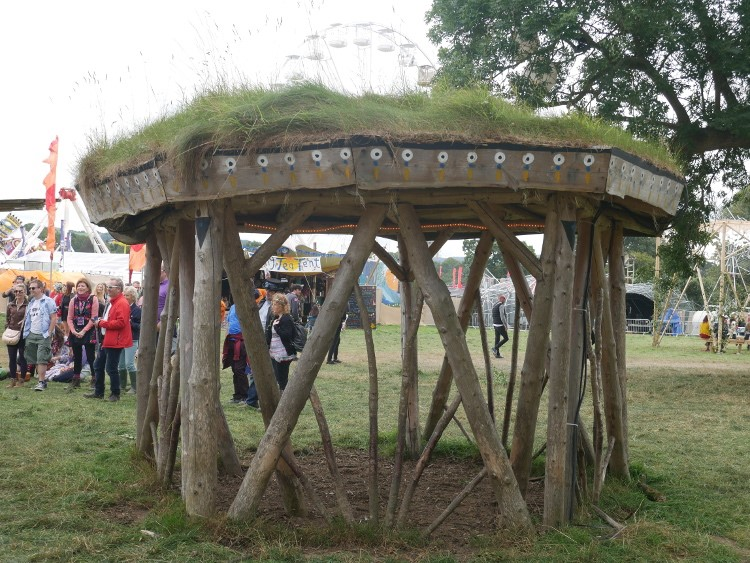 grass roofed structures could act as a den